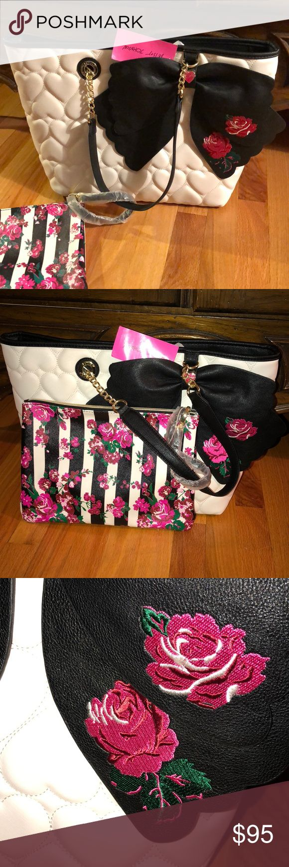 White/Black/ Rose Bow Purse! Gorgeous Betsey Johnson Purse!!! Snap closure on big purse, zipper on smaller inside purse. Black bow with two embroidered roses on the white side of the purse. Embroidered white heart puffy heart pattern on the front. Black puffy heart pattern on the back with gold Betsey hardware. Comes with an extra purse inside that can be used as a wristlet, or even an tablet case. 11 inches tall, 17 inches wide. Inside wristlet is 9 inches tall, 12 inches wide. Betsey…