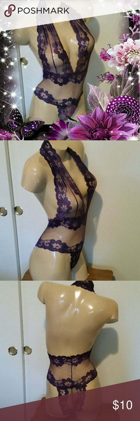 Purple lace lingerie Teddy This purple lace lingerie Teddy is absolutely gorgeous! slip-on, fits small through medium, show off your curves and look gorgeous while doing it, NEW. tags removed Intimates & Sleepwear Chemises & Slips