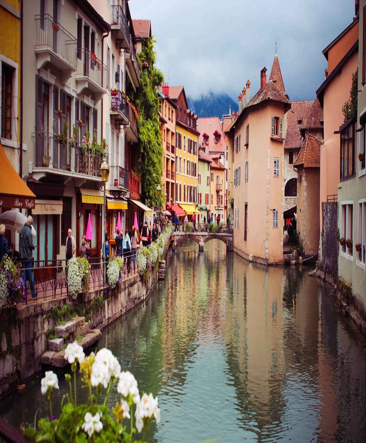 Annecy is an alpine town in southeastern #France, where the River Thiou meets Lac d'Annecy. It's known for its Vieille Ville, with cobbled streets, winding canals and pastel-colored #houses. Learn more about the beautiful places in France by checking out the Travel section of Talkinfrench.com https://www.talkinfrench.com/tag/french-tourism/