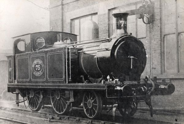 Photographed outside Aylesbury shed, this is the Metropolitan Railway's 2-4-0T D-Class locomotive No. 75 (works no. 4077). Six D-Class engines were produced, all of them being built by Sharp, Stewart & Co. in 1895. Withdrawn from service in 1922, they were the shortest and lightest of all the Metropolitan engines.