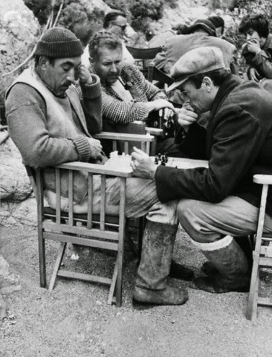 """Gregory Peck and Anthony Quinn playing chess, during the filming of """"Guns of Navarone"""" in Rhodes ~ 1960"""