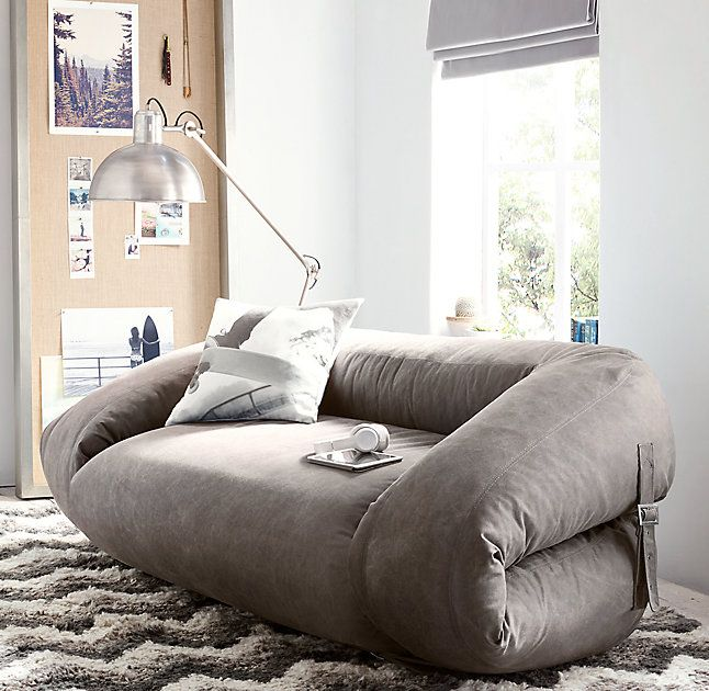 RH TEEN's Brower Convertible Lounger:Our ultra-casual, low-slung loveseat functions as a lounger when belted shut and transforms into into a futon-like bed when opened. Upholstered in distressed canvas for a relaxed vibe.