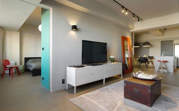 modern living room with bedroom wall break