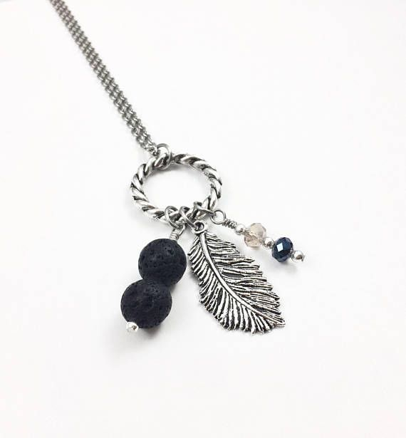 A beautiful silver feather lava stone essential oil diffuser necklace with glass crystal accent beads. Enjoy the scent and benefits of your favorite essential oil while wearing a lovely piece of jewelry, or just wear it as it is.  Lava stone is a grounding stone. It helps to give