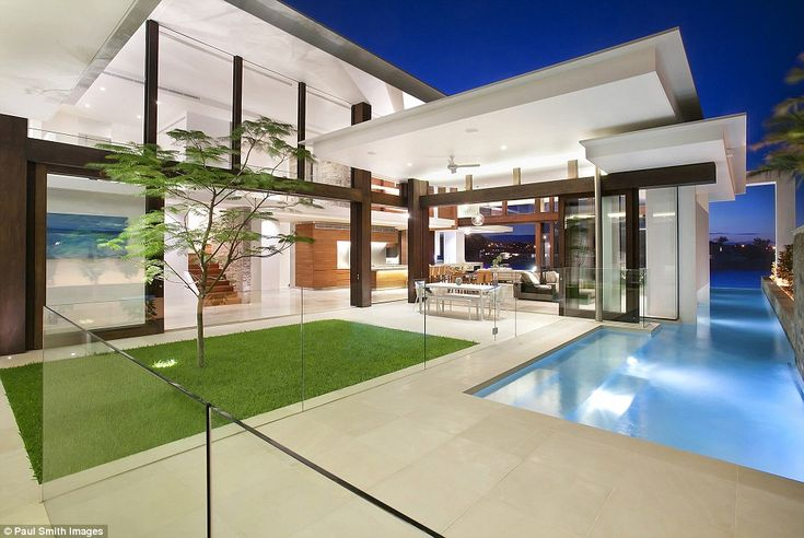 The 25 metre lap pool with an infinity edge runs straight up to the river, while the property also boasts its own jetty and pontoon