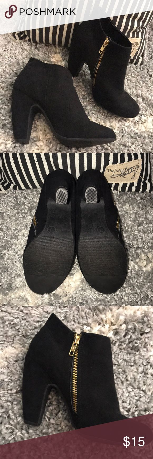 Black zip up booties Suade type material on outside; they have only been warn once, indoors. They have a taller heal so you may not feel comfortable walking if you aren't used to that.  Gold zipper on the side. Very clean, no odors or stains. A few small scuffs as seen in photos. Target Shoes Ankle Boots & Booties