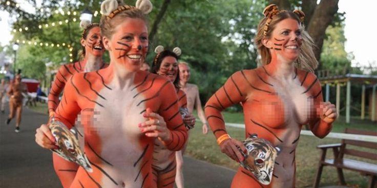 Πέταξαν τα ρούχα τους, βάφτηκαν τίγρεις και έτρεξαν γυμνοί στους δρόμους του Λονδίνου – Δείτε ΦΩΤΟ