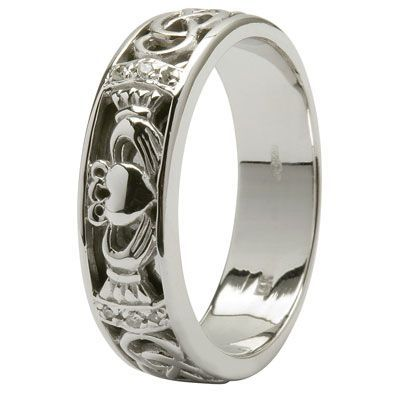 Claddagh ring hands=friendship heart=love crown=loyalty.  Ryan already knows that this is what I want. Not neccessarily this style, as I'd rather the crown be poking out, but the idea/message is still the same.