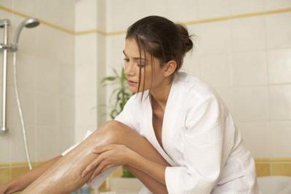 woman applying vitamin K cream to legs