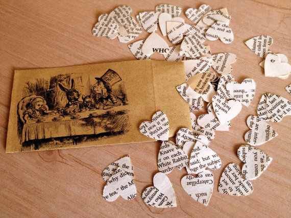 heart-shaped confetti (or any shape, really—e.g., top hat, rabbit, butterfly, teapot/cup) punched out from the tea party chapter in Alice in Wonderland