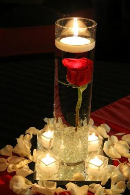 Two of these with either a lantern or candelabra in the middle..flower petals surrounding them