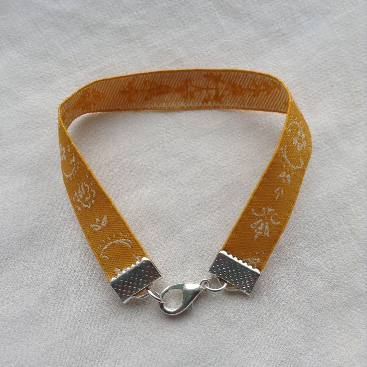 Gold / yellow ribbon bracelet with lace detail