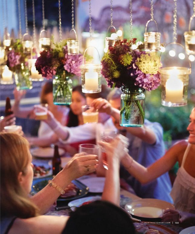 Love the hanging candles and mason jars with flowers!