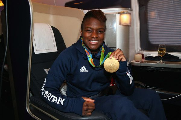 Nicola Adams of Great Britain poses with her gold medal during the Team GB flight back from Rio on British Airways flight BA2016 on August 22, 2016 in Rio de Janeiro, Brazi