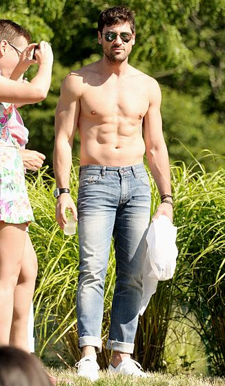 God bless America! Maksim Chmerkovskiy went shirtless during the Stadium Red White  Blue bash in the Hamptons over the July 4th weekend.