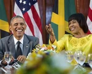 Prime Minister Portia Simpson-Miller and the president shares a happy moment at a reception in Jamaica.