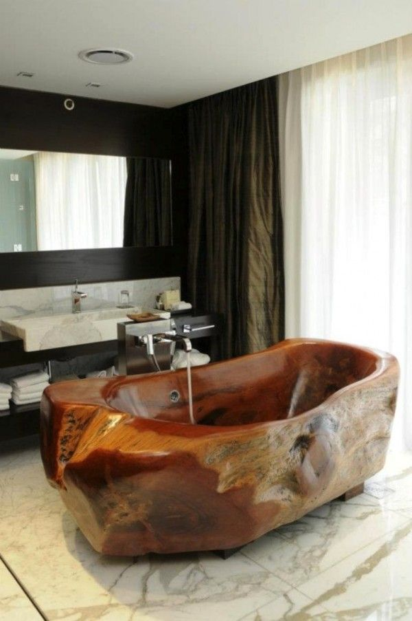 Petrified wood tub carved by artist Mario Dasso | Mio Buenos Aires Hotel | interiors by Beasley & Henley Interior Design of Florida, U.S.A.