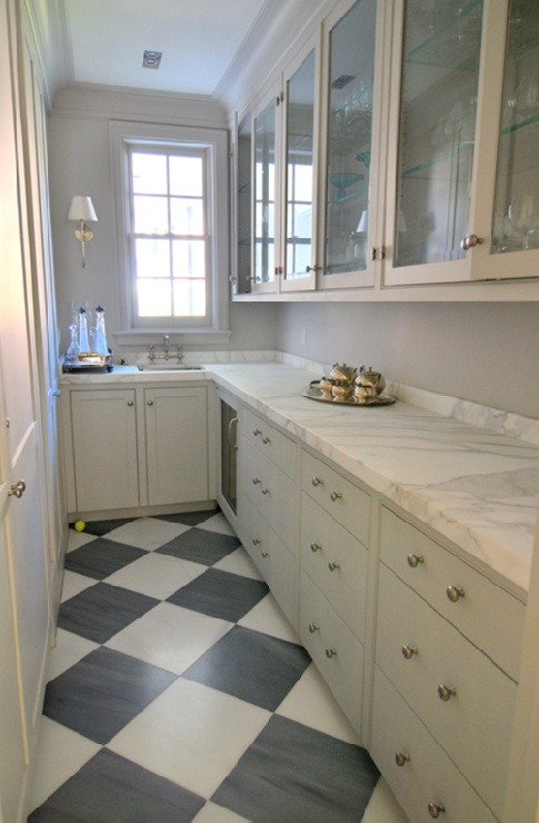 kitchens - galley butler's pantry white black checkered tiles floor gray glass-front kitchen cabinets marble countertops Bryant Sconce Amazing
