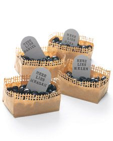 paper brown lunch sack cut at fold, careful not to cut bottom of bag, use martha's fence edge punch for top, fill with candy, make gravestones out of gray card stock, round off top with a circle, stamp words on