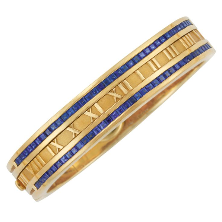 Gold & Sapphire Atlas Bangle by Tiffany & Co...continuous line of polished gold Roman numerals edged with 76 square cut sapphires