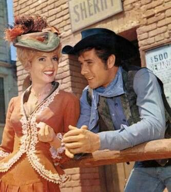 "Robert Fuller, Ruta Lee in LARAMIE episode, ""Siege at Jubilee."" The also stared together on Wagon Train, season 2, episode 31, ""The Kate Parker Story""."