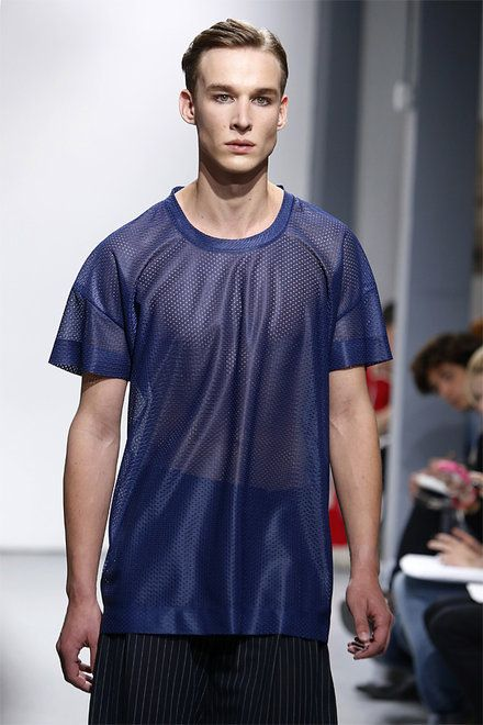 A model wears a creation by fashion designer Stephanie Hahn for 22/4 Hommes Femmes men's fashion Spring-Summer 2014 collection, presented Thursday, June 27, 2013 in Paris. (AP Photo/Francois Mori)