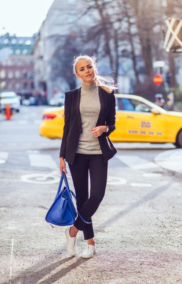 Janni Deler is wearing a black suit from Janni for Sanne and the white slip-on sneakers are from Nilson -- http://www.justthedesign.com/suits-and-sneakers/