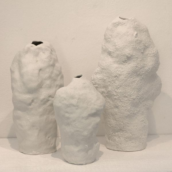 Czech designer Maxim Velčovský creates his Snow Vases by molding snow into the shape of vases and then casting them in plaster.