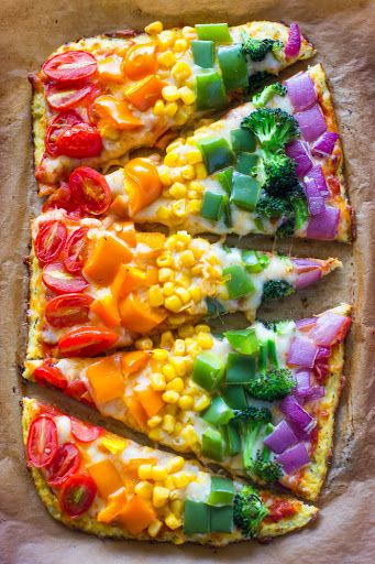Rainbow Cauliflower Crust Pizza With Cauliflower, Shredded Parmesan Cheese, Mozzarella Cheese, Eggs, Salt, Garlic Powder, Basil, Oregano, Marinara Sauce, Mozzarella Cheese, Bell Pepper, Broccoli Florets, Diced Red Onions, Canned Corn, Tomatoes