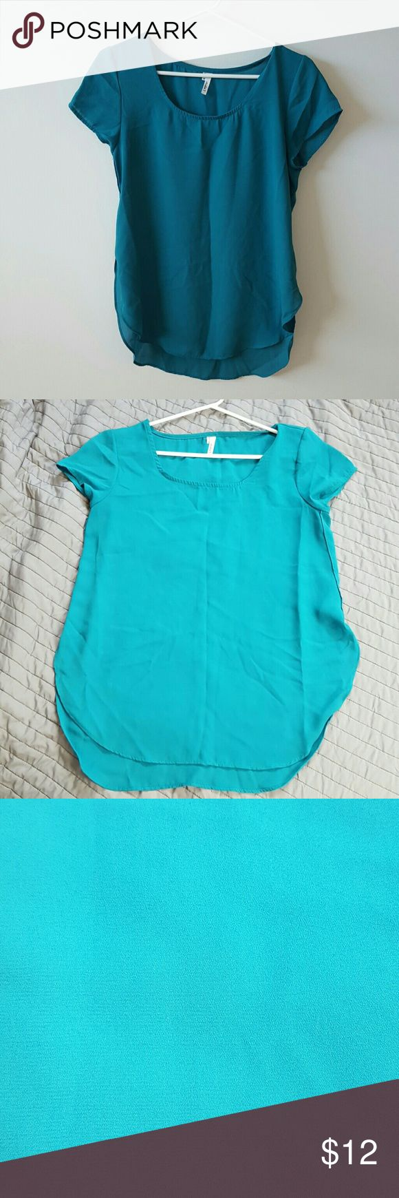 Teal blouse Light weight blouse, high slits at sides,cap sleeves, scoop neck, worn a few times Studio Y Tops Blouses