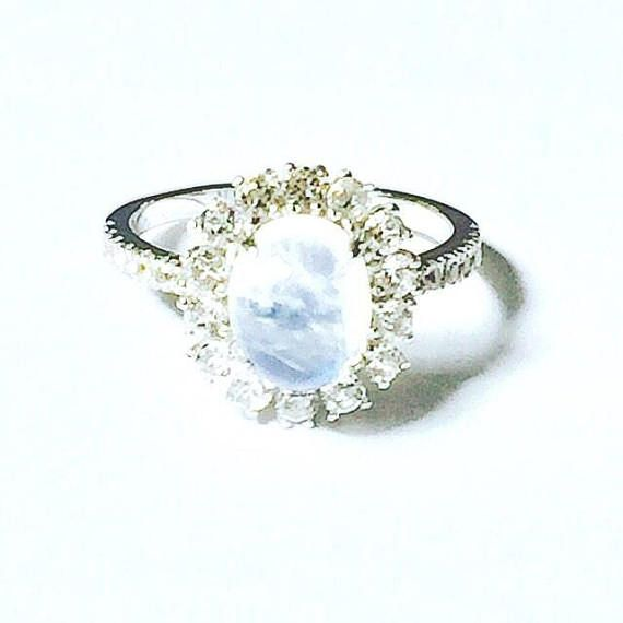 Rainbow Moonstone Halo Ring Or Engagement Ring W/ White Topaz Halo Handmade Jewelry By NorthCoastCottage Jewelry Design & Vintage Treasures A large, nearly 2CT oval rainbow moonstone gemstone from India, set in a white topaz halo totaling a full 1CT - what a celestial combination!