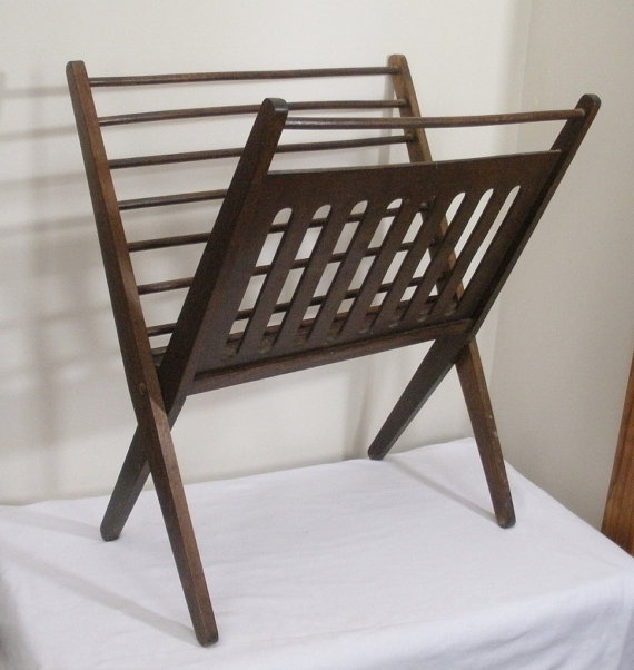 Vintage Danish Modern magazine rack. Could use in guest bath for clean bath towels