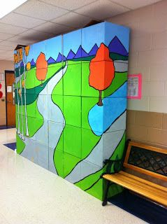 Make a mural out of stacked boxes, so it can be deconstructed and reassembled to display anywhere! Paint both sides in different designs, only use a vertical stack like a totem pole... so many options! Portable, temporary, collaborative!
