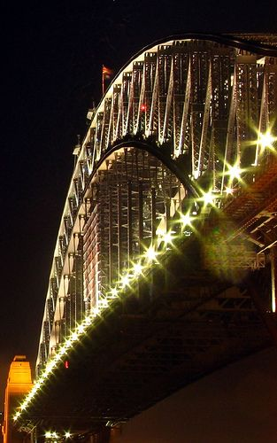 Harbour Bridge: is the world's most massive steel arch bridge. The bridge opened in 1932. From here, the most spectacular view of Sydney Harbor can be experienced. The Bridge Climb can be taken during the day, twilight, or night for different panoramic perspectives.  via Kel Stal