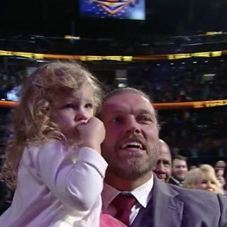 WWE Hall of Fame Superstar Edge (Adam Copeland) hoisting up his daughter Lyric to get a better look at her mom WWE Superstar Beth Phoenix (Beth Kocianski Copeland) take her place in the WWE Hall of Fame Class of 2017 #WWE #WWEHOF