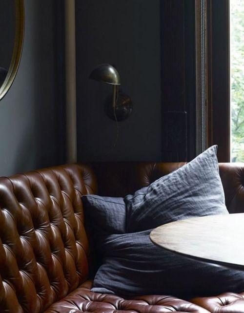carmel leather, blue linen, slate walls, brass