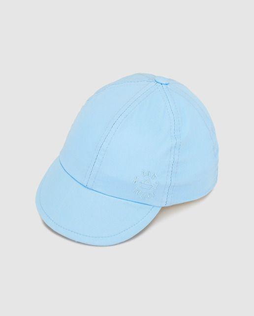 Gorra de bebé niño Freestyle con bordado azul  25f757c619f