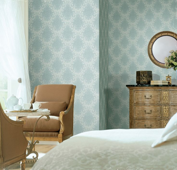 This soft aqua wallpaper pattern and color combo really make this room bright and welcoming. #wallpaper