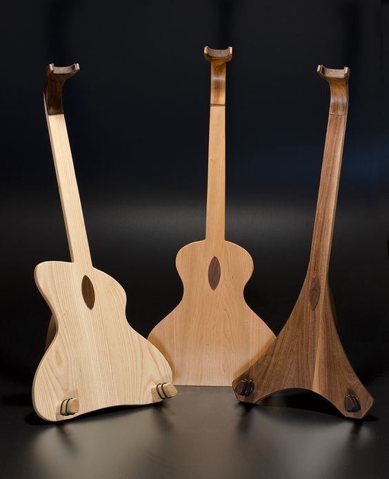 12 best guitar shaped guitar stands and stuff images on pinterest guitar stand guitars and. Black Bedroom Furniture Sets. Home Design Ideas