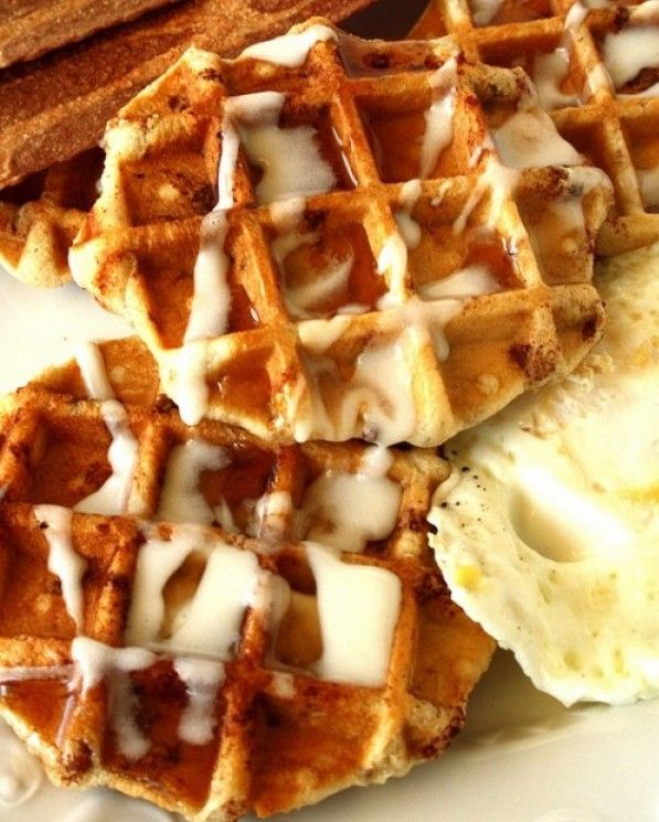 Pillsbury Brand Cinnamon Buns Cooked On A Waffle Iron And Topped With Icing.