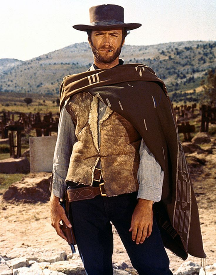 This picture of clint eastwood is a signifier that this film is a western. From the cowboy hat, pistol hostler to the desert background are signs that this is a western movie.