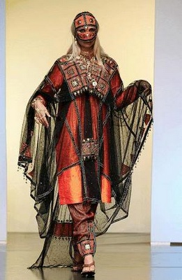 This is also inspiration for traditional dress from Da'har - Idris' (fictional) homeland...I'd wear that (without the face mask part!) - beautiful orange, no?