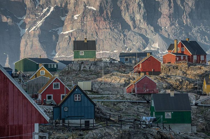 Greenland | Lawrence Hislop Photography. Colored houses and rocky mountain in Greenland.
