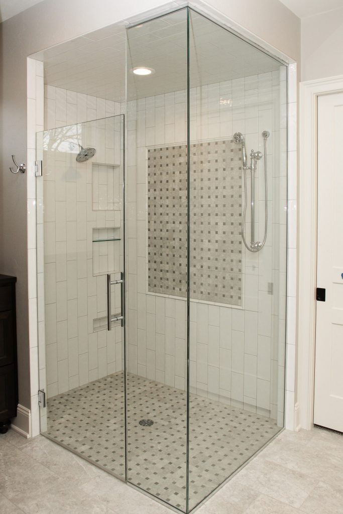 White Tiled Shower With Accent Floor And Accent Square Glass