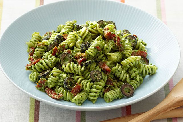 This easy Mediterranean-inspired salad of rotini pasta, black olives and sun-dried tomatoes is tossed with a creamy pesto dressing.