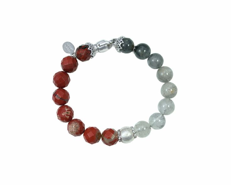 Made with Red Jasper and grey Quartz, the bracelet Rock it! Jasper is full of splendor and deep meanings. The Red Jasper is the stone of deep personal equity and justice, that supports the person in times of stress by bringing a sense of calm and consciousness. The grey Quartz is useful to instil the courage and the will to improve. Ideal for any occasion, the brilliance and the intense shade of red gives a touch of color to any outfit.