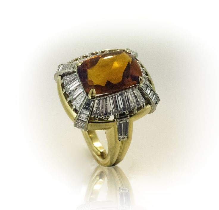 Statement ring in yellow & white gold with citrine and baguette diamonds.