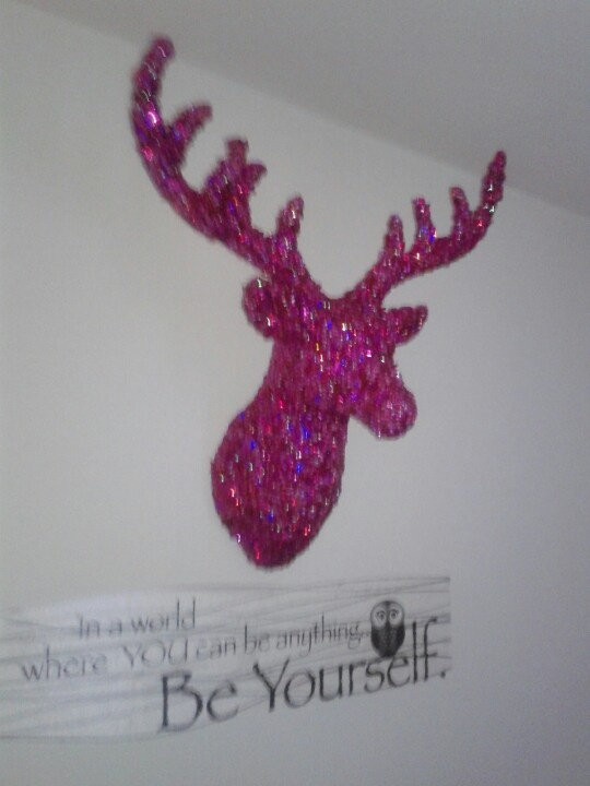 I want this deer head . Its pink and sparkly