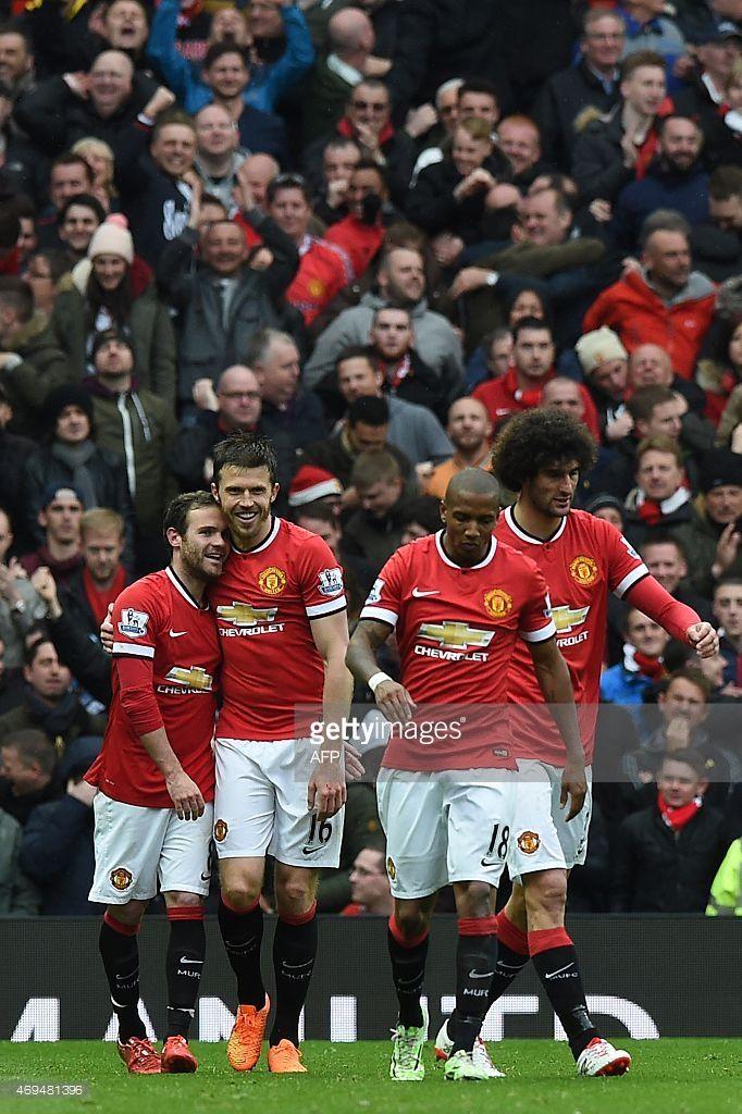 Manchester United's Spanish midfielder Juan Mata (L) celebrates with teammates after scoring their third goal