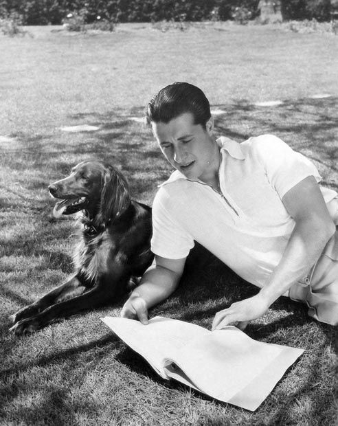 0 Don Ameche with his Irish setter